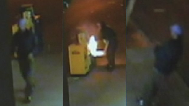 Investigators hope someone can identify the man seen in surveillance photos. (Courtesy Asheville-Buncombe Arson Task Force)