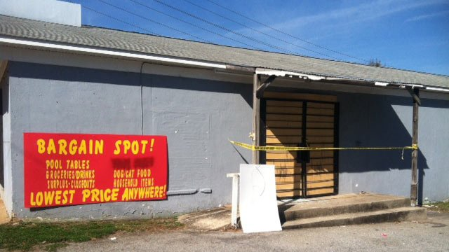 The Bargain Spot boarded up after Monday's robbery. (Oct. 23, 2012/FOX Carolina)