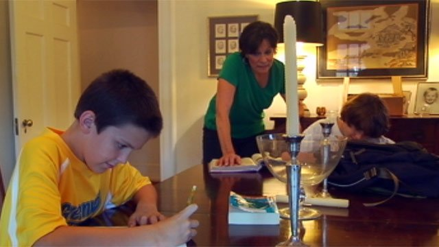 Kathryn Algary helps her grandsons with their homework. (Oct. 23, 2012/FOX Carolina)