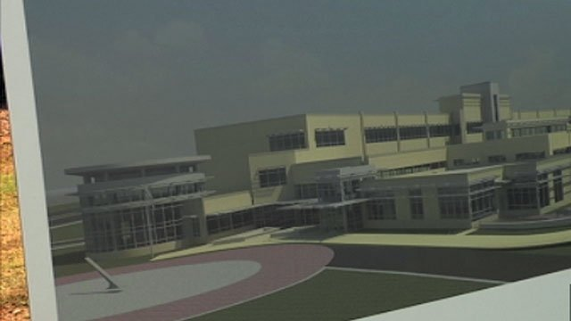 An artist's rendering of the future Dr. Phinnize J. Fisher Middle School is displayed at a groundbreaking ceremony. (Oct. 24, 2012/FOX Carolina)