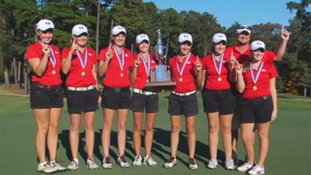 The Greenville High School girls' golf team holds their state championship trophy. (File/FOX Carolina)