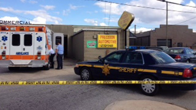 Precision Automotive in Greenville is cordoned off after a shooting. (Oct. 25, 2012/FOX Carolina)