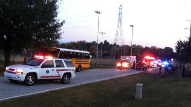 Emergency vehicles are parked along Ridge Road after a child waiting for a school bus was hit by a car. (Oct. 26, 2012/FOX Carolina)
