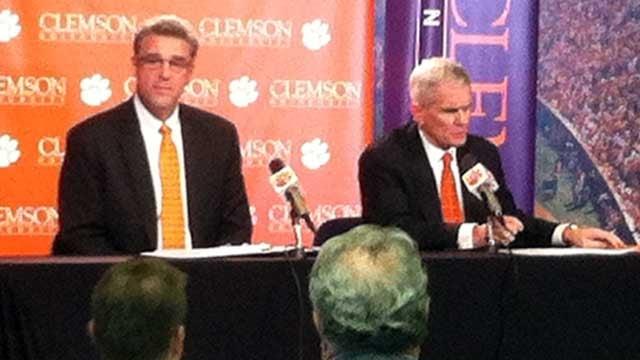 Dan Radakovich (left) looks over the media as Clemson President James Barker (right) announces his hiring. (Oct. 29, 2012/FOX Carolina)