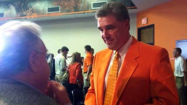 Dan Radakovich (right) dons the traditional orange blazer given to Clemson athletics staff. (Oct. 29, 2012/FOX Carolina)