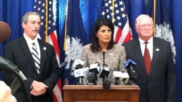 Gov Nikki Haley along with SC State Law Enforcement Director Mark Keel (left) and SC Dept. of Revenue director James Etter at Tuesday's press conference. (Oct. 30, 2012/FOX Carolina)