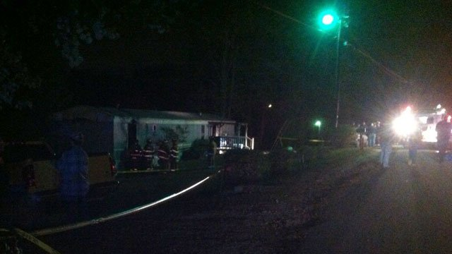 Firefighters mill about the scene of a fatal fire at a home in Marietta, SC. (Oct. 30, 2012/FOX Carolina)