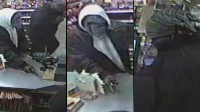 Surveillance photos of the two robbery subjects. (Greenville Police Dept.)
