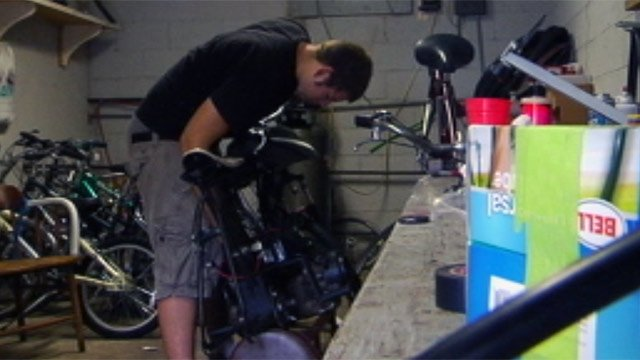 TJ Holka works on his re-engineered bike. (File/FOX Carolina)