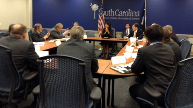 South Carolina Gov. Nikki Haley (center background) meets with her Cabinet to discuss the hacking case at the SCDOR. (Nov. 1, 2012/FOX Carolina)