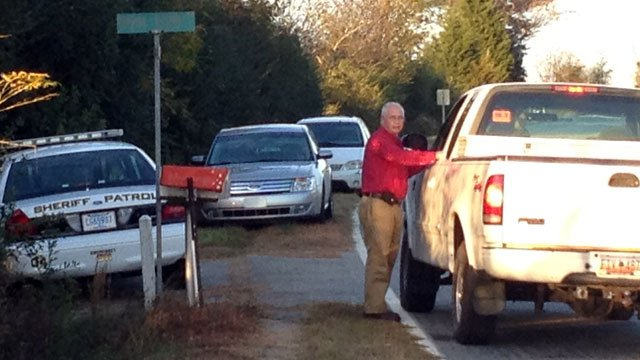 A deputy's cruiser blocks off Smith Farm Road after a stabbing near Westminster. (Nov. 2, 2012/FOX Carolina)