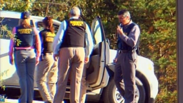 Officers mill about the scene of a standoff in the parking lot of a Walmart store in Travelers Rest. (Nov. 5, 2012/FOX Carolina)