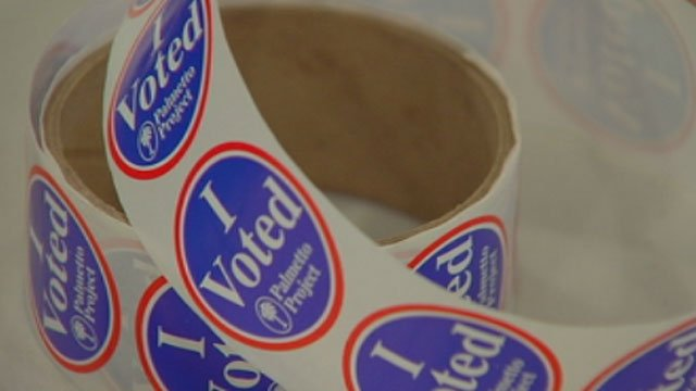 A roll of stickers, each of which is given to voters, lays on a table at a polling place. (File/FOX Carolina)