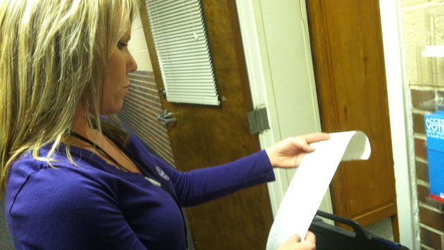 An election worker in Oconee County prints off the voting roll for a machine. (Nov. 6, 2012/FOX Carolina)