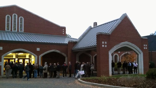 Voters wait in line before polls opened at 7 a.m. at St. John's Lutheran Church on Pine St. in Spartanburg. (Nov. 6, 2012/FOX Carolina)