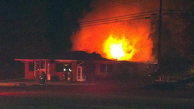 Flames burn through the back of Traveler's Restaurant on Highway 25. (Nov. 8, 2012/FOX Carolina)