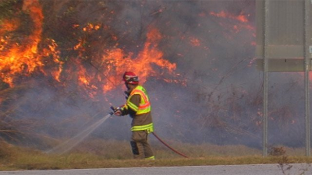 The brush near a crash along Highway 11 burns after one person died in the wreck. (Nov. 11, 2012/FOX Carolina)
