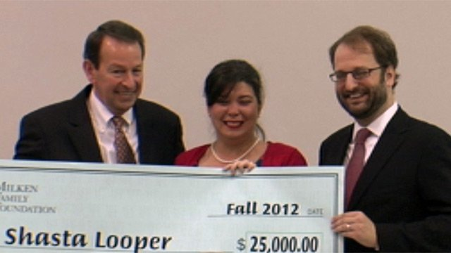 Shasta Looper is presented her check after winning the Milken award alongside Dr. Mick Zais and Jason Culbertson. (Nov. 12, 2012/FOX Carolina)