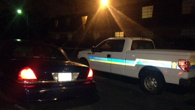 The vehicles of investigators are parked at the scene of a shooting at Grove Station Apartments in Greenville County. (Nov. 12, 2012/FOX Carolina)