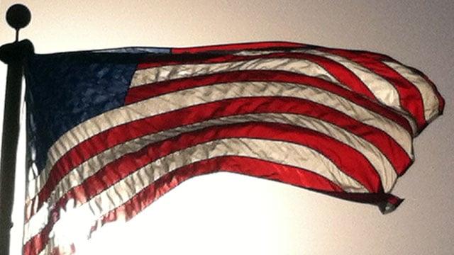 The American flag waves atop a flag pole. (File/FOX Carolina)