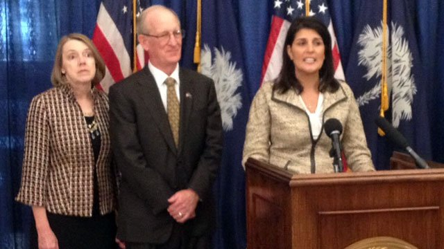 Ray Farmer and his wife (left) stand alongside South Carolina Gov. Nikki Haley as she announces him as her pick to lead the Insurance Department. (File/FOX Carolina)