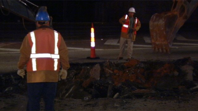 Repair crews work on the ruptured main along White Horse Road. (Nov. 13, 2012/FOX Carolina)