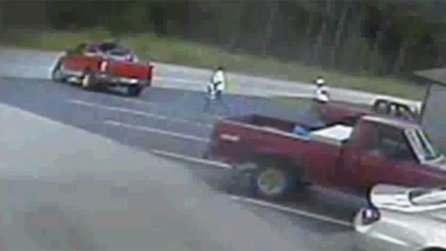 The Ford F150 (left) leaves the Villager store on Highway 187. (Oct. 2, 2012/Anderson Co. Sheriff's Office)