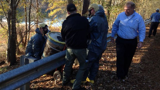 Anderson County Coroner Greg Shore (right) watches as crews wheel a second drum from Lake Hartwell. (Nov. 15, 2012/FOX Carolina)