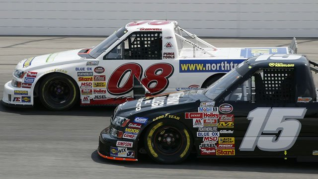 Mike Greenwell (08), former Boston Red Sox player making his NASCAR Truck debut, passes Kyle Krisitoff during the City of Mansfield 250 NASCAR Truck race Saturday, May 27, 2006 in Mansfield, Ohio. (AP Photo/Jay LaPrete)