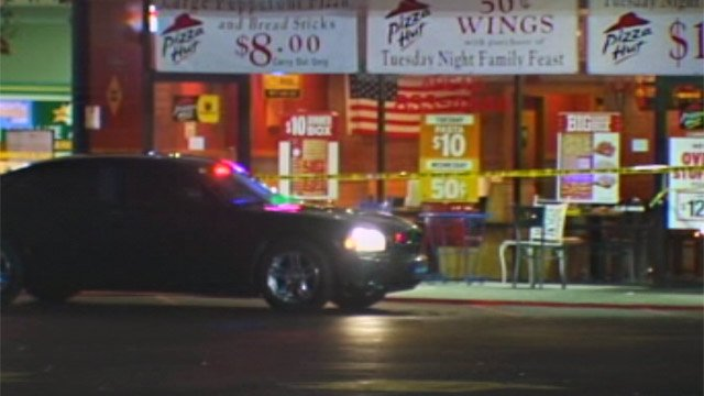 Police investigate a shooting at the Pizza Hut restaurant on S. Broad Street. (Nov. 19, 2012/FOX Carolina)