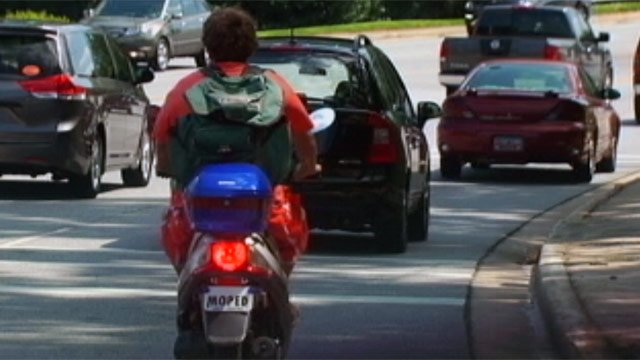Donny Skilton rides his moped on an Upstate road. (File/FOX Carolina)