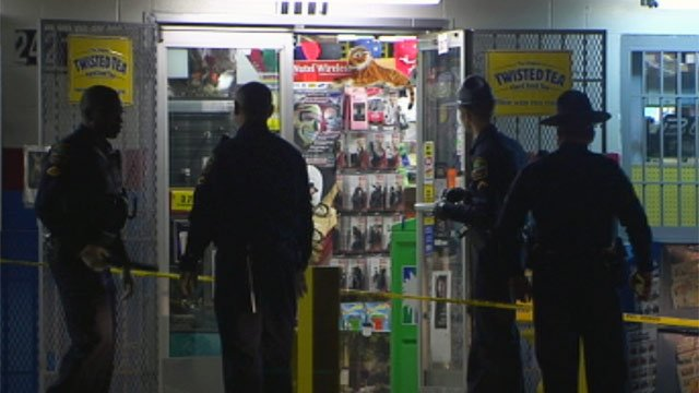 Deputies investigate a shooting at the Lake Stop Convenience Store in Inman. (Nov. 19, 2012/FOX Carolina)