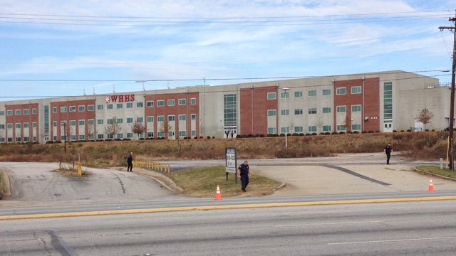 Deputies stand outside of Wade Hampton High School following the arrest of a shoplifting suspect nearby. (Nov. 20, 2012/FOX Carolina)