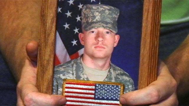 Dennis Hicks holds a photo of his nephew Sgt. Bo Hicks. (Nov. 20, 2012/FOX Carolina)