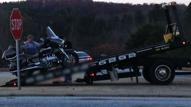 A worker loads a motorcycle involved in a fatal crash onto a wrecker. (Nov. 21, 2012/FOX Carolina)