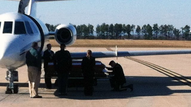 Hicks' is honored upon his remains' arrival at GSP. (Nov. 26, 2012/FOX Carolina)