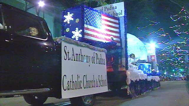 The float of a Catholic church and school rolls down Main Street in Greenville during the annual Poinsettia Christmas parade. (Dec. 2011/FOX Carolina)