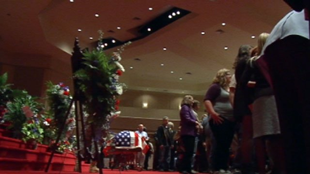 Hundreds of mourners stream past Hicks' casket during a visitation. (Nov. 27, 2012/FOX Carolina)