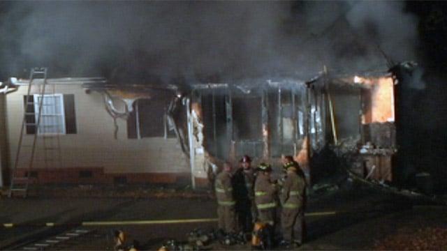 Smoke rises from a duplex along Shirley Circle after a fire. (Nov. 30, 2012/FOX Carolina)