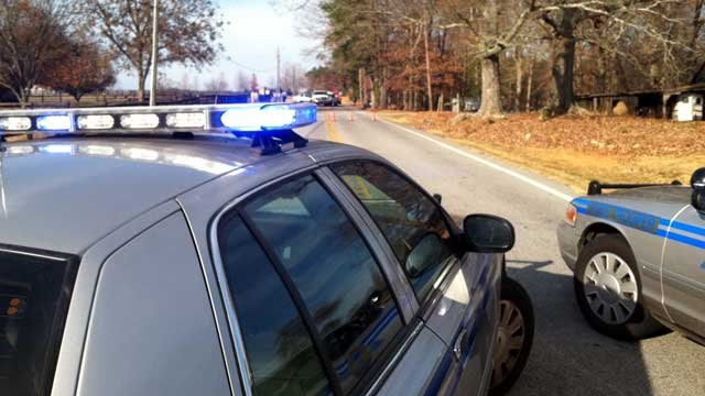 Two Highway Patrol vehicles block off Jackson Grove Road after a fatal crash. (Dec. 1, 2012/FOX Carolina)