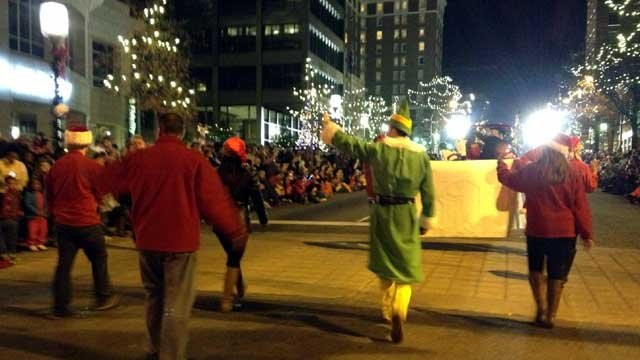 A group from FOX Carolina marches down Main Street during the annual Greenville Poinsettia Christmas Parade. (Dec. 1, 2012/FOX Carolina)