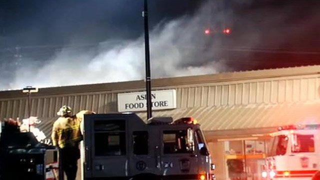 Firefighters fight a Spartanburg shopping center fire. (Dec. 3, 2012/FOX Carolina)