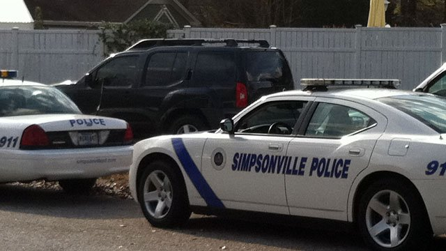 Simpsonville police are parked near a home where they said a meth lab was found. (Dec. 4, 2012/FOX Carolina)