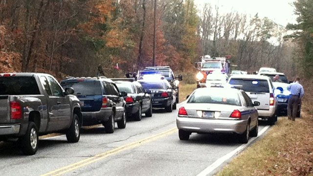 Several emergency vehicles are parked at the scene of a crash involving a pursued vehicle in Anderson County. (Dec. 4, 2012/FOX Carolina)