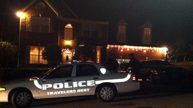 Police officers stand guard at a Travelers Rest home where two bodies were found. (Dec. 4, 2012/FOX Carolina)
