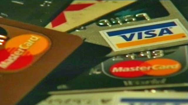 A stack of credit cards is displayed on a table. (File/FOX Carolina)