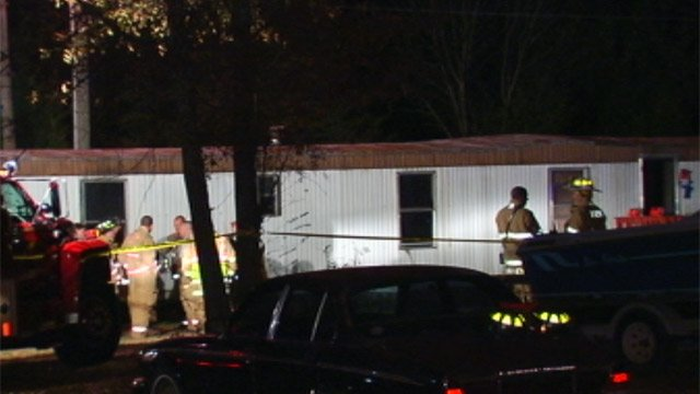 Firefighters investigate a fire where a man was found dead inside the Cox Road mobile home Thursday. (Dec. 6, 2012/FOX Carolina)