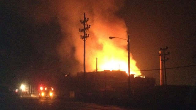 Flames shoot through the roof of the mill. (Dec. 8, 2012/FOX Carolina)