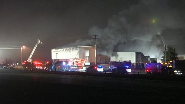 Smoke billows from the Platronics Seal plant in Spartanburg. (Dec. 10, 2012/FOX Carolina)