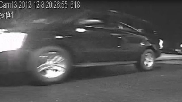 A security photo of the black 2005 Dodge Durango with silver wheels, tinted windows and blue tinted headlights deputies are looking for. (Pickens Co. Sheriff's Office)